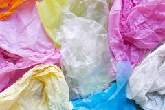 Colorful plastic bags waste. Background royalty free stock photography