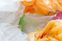 Colorful plastic bags waste. Background stock photos