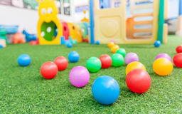 Colorful plastic ball on green turf at school playground stock photos