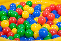 Colorful plastic balls on children's playground Stock Photo
