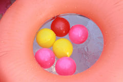 Colorful plastic balls floating on the water Stock Photo