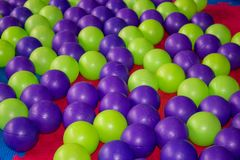 Colorful plastic balls in pool,Game room with balls colored stock images