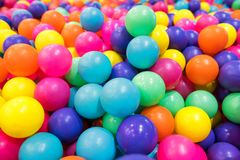 Colorful plastic balls in pool or pit. Colorful plastic balls in playground ball pool. children entertainment amusement indoor park stock image