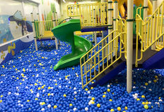 Colorful plastic balls and stair on with slider. In children playground Royalty Free Stock Photos