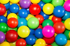 Colored balls to play 3. Colorful plastic balls in which children can jump, swim and play Stock Photo
