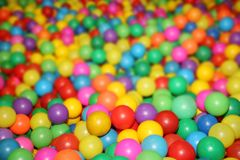Colored balls to play 7. Colorful plastic balls in which children can jump, swim and play Stock Images