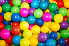 Colored balls to play 1. Colorful plastic balls in which children can jump, swim and play Stock Image