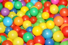 Colored balls to play 6. Colorful plastic balls in which children can jump, swim and play Stock Photography