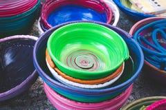 Colorful of polyethylene baskets stock images