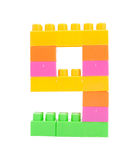 Colorful plastic blocks forming the number nine Royalty Free Stock Photography