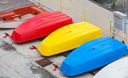 Colorful plastic boats lay on the pier, Black Sea coast Stock Photography