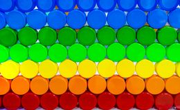 Colorful plastic bottle cap arrange with beautiful tone and pattern. Blue, green, yellow, orange, and red plastic bottle cap. Arrange with orderly. Cap for Stock Image