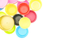 Colorful plastic bottle cap recycling garbage isolated Royalty Free Stock Images