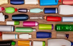 Colorful plastic bottles on wooden surface Royalty Free Stock Photography
