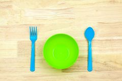 Colorful plastic bowl and Cutlery. For a children Royalty Free Stock Photos