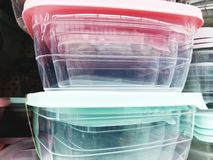 Colorful plastic bowls displayed on shelves for sale in a supermarket.  royalty free stock photography