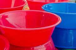 Colorful plastic bowls. On the open market stock image