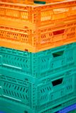 Colorful plastic boxes stacked one upon the other on warehouse trolley or platform trolley. Colorful plastic boxes stacked one upon the other stock image