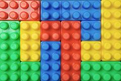 Plastic brick toys. Colorful plastic brick toys. Close up. Top view Royalty Free Stock Images