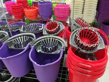 Colorful plastic buckets for menagerie Stock Image