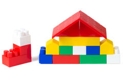 Colorful plastic building blocks house on white 3. Colorful plastic building blocks house on white background royalty free stock image