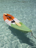 Colorful plastic canoe on water sandy beach. Coast of andaman sea. Royalty Free Stock Photography