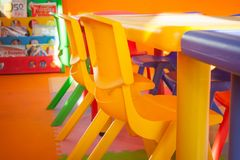 Colorful plastic chair and desk for children playing and learning in kids room in vintage style. royalty free stock photo