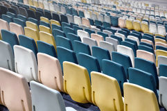 Colorful plastic chairs. Rows of colorful plastic chairs on the back side Royalty Free Stock Image