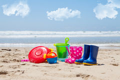 Colorful plastic children's toys on the beach Stock Image