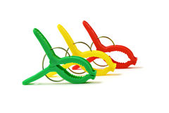 Colorful plastic clothes pegs Royalty Free Stock Image