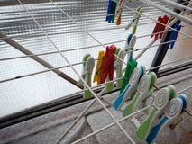 Colorful plastic clothes pegs on lines Stock Photos