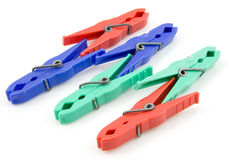 Colorful plastic clothespins Stock Photos