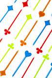 Colorful plastic cocktail sticks on white background Stock Images