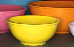 Colorful Plastic Cooking Bowls. An assortment of sizes and colors of mixing bowls for kitchen use Royalty Free Stock Images