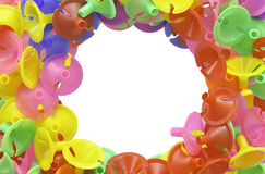 Colorful plastic cups for latex balloon on white Stock Photos