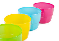Colorful plastic cups in the outgoing term Royalty Free Stock Photography