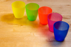 Colorful plastic cups Royalty Free Stock Images