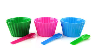 Colorful plastic cups with spoons Stock Images