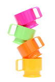 Colorful plastic cups. Stack of colorful plastic cups isolated on white background Royalty Free Stock Photo