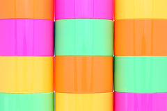 Colorful plastic cups. Stack of colorful plastic cups, texture background, closeup Stock Image