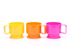 Colorful plastic cups. On white background Royalty Free Stock Image