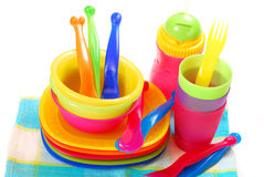 Colorful plastic dishes Royalty Free Stock Photos