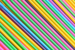 Colorful plastic straws. Colorful plastic drinking straws in diagonal pattern background royalty free stock photo