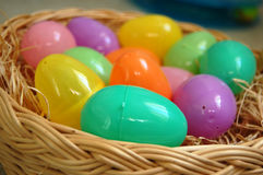 Colorful Plastic Easter Eggs. In a basket Royalty Free Stock Images