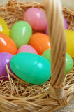 Colorful Plastic Easter Eggs. In a basket Stock Images