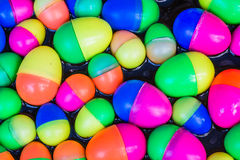Colorful plastic eggs toys floating on the water. Stock Photo