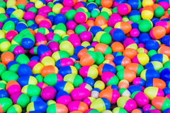 Colorful plastic eggs toys floating on the water. Royalty Free Stock Photos