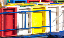Colorful plastic fish containers in a port Stock Image