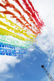 Colorful Plastic Flag Create by Recycle Concept. Colorful Plastic Flag Sign under the Clear Blue Sky, Creativity From Garbage into the New Thing under the Stock Images