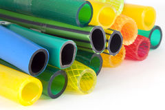 Colorful plastic gardening hoses Royalty Free Stock Photos